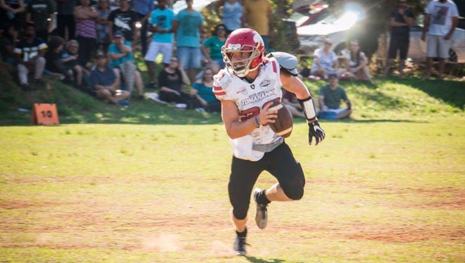 Former Brown Deer standout Jake Schimenz playing for Tomahawk, a professional football team in Brazil.