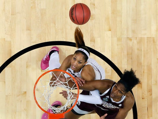 South Carolina forward A'ja Wilson, left, and Mississippi State center Teaira McCowan, right, battle for a rebound during the first half in the final of NCAA women's Final Four college basketball tournament, Sunday, April 2, 2017, in Dallas. (AP Photo/Tony Gutierrez)