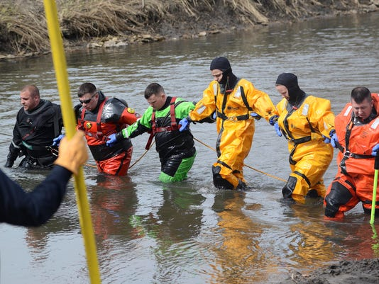 Dive teams search for Jake Wilson