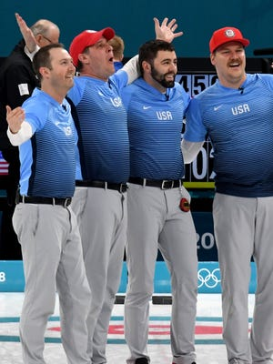 Team USA celebrates winning the gold medal in curling.