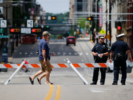 Cincinnati police officers work at the intersection