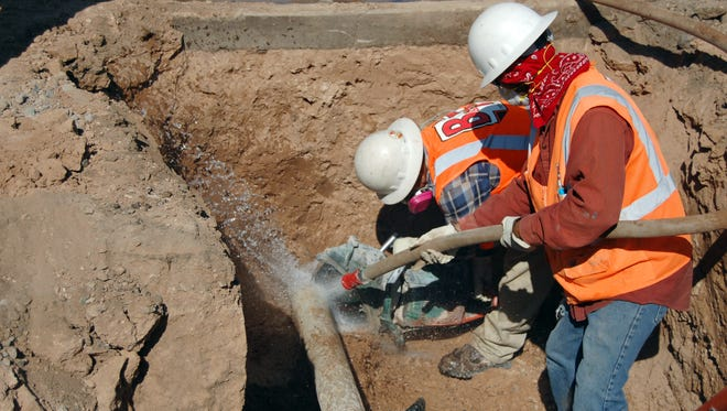 Construction workers renovate deteriorated water-pipes in this 2012 photo from Youngtown. Officials worry that small water companies will struggle to pay for needed upgrades as drought and environmental concerns put more pressure on them.