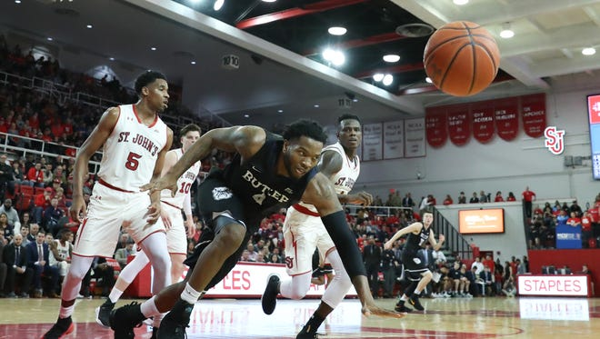 Butler Bulldogs forward Tyler Wideman (4) chases a loose ball during the first half against the St. John's Red Storm at Carnesecca Arena.