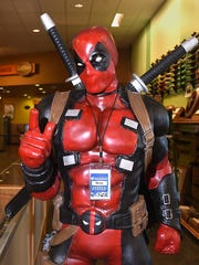 A large likeness of Deadpool welcomes visitors to EntertainMART on Wednesday at 3020 E. 20th St. in Farmington.