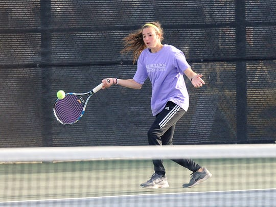 Wylie's Madison Andrews lines up a shot during the Region I-4A girls doubles final at Texas Tech's McLeod Tennis Center on Thursday, April 19, 2018. Andrews and Hailey Parker won the championship 3-6, 6-4, 7-5.