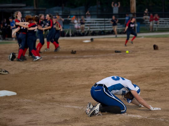 Memorial's Soffia Rieckers (15) collapses after grounding out against Heritage Hills for the final out of the game during the 3A IHSAA Boonville Sectional Thursday evening.