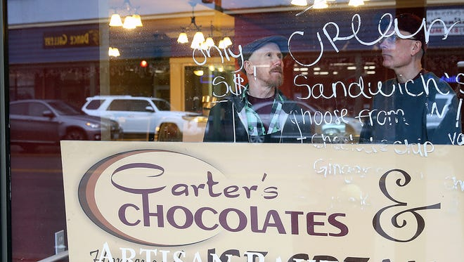 Owners John Strasinger and Matt Carter are moving Carter's Chocolates & Ice Cream to 707 Bay Street in downtown Port Orchard in a former bakery.