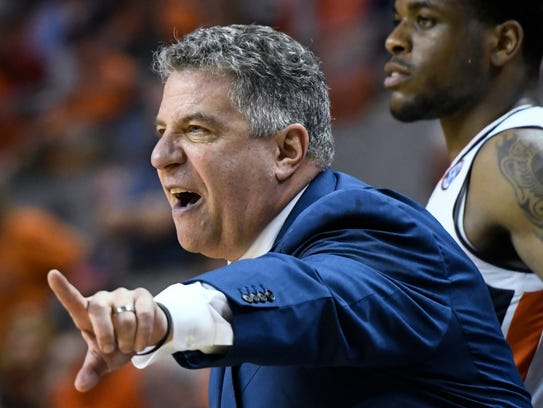 Auburn coach Bruce Pearl gestures during the second