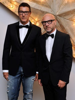 FILE - JUNE 19: Italian fashion designers Domenico Dolce and Stefano Gabbana of Dolce & Gabbana have been convicted of tax evasion by an Italian court and given a 20 month suspended sentence. LONDON, ENGLAND - JULY 14:  (L-R) Stefano Gabbana and Domenico Dolce attend a party for Dolce And Gabbana hosted by Net-a-Porter at Westfield on July 14, 2011 in London, England.  (Photo by Gareth Cattermole/Getty Images)