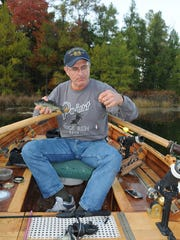Patrick Durkin unhooks an eating-size bluegill.
