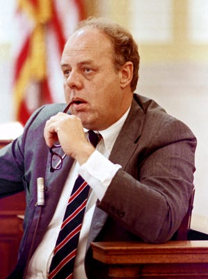 FILE – In this June 23, 1989, file photo, John M. Dowd, the lawyer whose investigative report got Pete Rose kicked out of Major League Baseball for gambling, listens to a question from a lawyer for Rose during testimony before Hamilton County Common Pleas Court Judge Norbert A. Nadel in Cincinnati. A woman said she had a sexual relationship with Rose in the 1970s, starting when she was 14 or 15 years old, according to her sworn testimony submitted to a court Monday, July 31, 2017, in a federal defamation lawsuit Rose filed against Dowd in 2016. (AP Photo/Al Behrman, File)