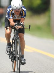 Carl Grove trains on an Elkhart County road near Bristol, Ind., in preparation for his return trip to the age-group world championships in Austria in 2011.