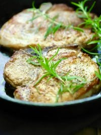 Easy Baked Pork Chops with Garlic and Rosemary are juicy and full of flavor.