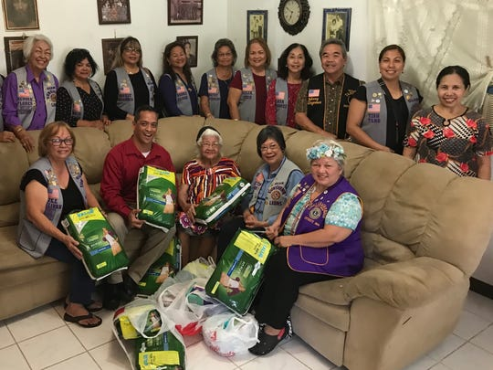 "In keeping with the club's mission of ""Caring for the Sick and the Elderly,"" Guam Sunshine Lions Club members brought supplies, song, and cheer to Mrs. Francisca Argenal, 84, of Latte Plantation on Feb. 10. Pictured with Argenal from left: Lions Jill Pangelinan, Frank Aguon, Marietta Camacho and Ewy Taitano.  Standing from left: Lions Pete Babauta, Lola Flores, Connie Rivera, Sophie Losongco, Bobbie Flores, Dot Leon Guerrero, Julie Cruz, Linda Villagomez, Johnny Villagomez (Guam Tano-ta Branch Club), Tish Tano, and Ms. Erlyn Pama."