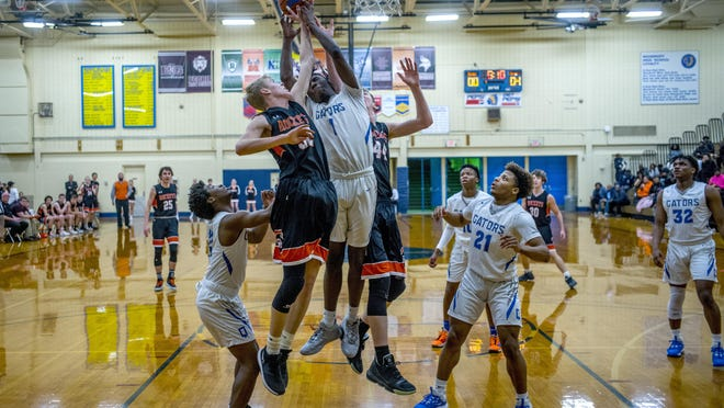 Peoria Quest's Isaiah Brown (1) goes up strong against Roanoke Benson's Logan Nix (32) and Luke Braman (44) on Tuesday. Wethersfield plays Quest at 7:30 p.m. Saturday in the Great Western Shootout in Abingdon.