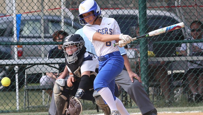 North Salem's Maggie Boardman hits a single scoring the tying and go ahead run in the 7th inning against Pine Plains in the Class C state regional semifinal at Rhinebeck High School June 2, 2016. North Salem won the game 7-6.