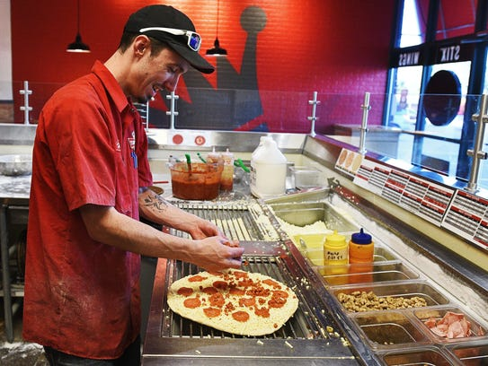 A Toppers Pizza shift leader in Sioux Falls makes a