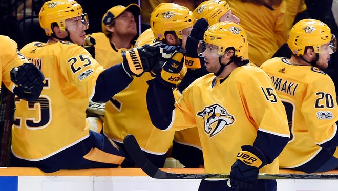Nashville Predators defenseman Alexei Emelin (25), of Russia, congratulates right wing Craig Smith (15) after Smith scored a goal against the Colorado Avalanche during the first period of an NHL hockey game, Saturday, Nov. 18, 2017, in Nashville, Tenn.