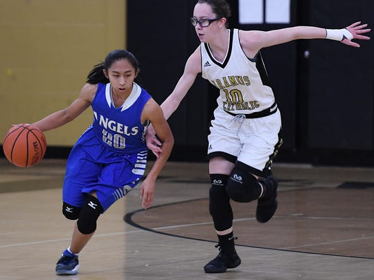 High school girls basketball game between Holy Angels at Paramus Catholic on Thursday, Jan. 26 2017. (left) HA #20 Elena Pulanco tries to get past PC #10 Natalie Stanton.