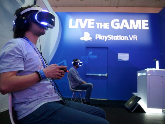 Gamers play the PlayStation virtual reality game The