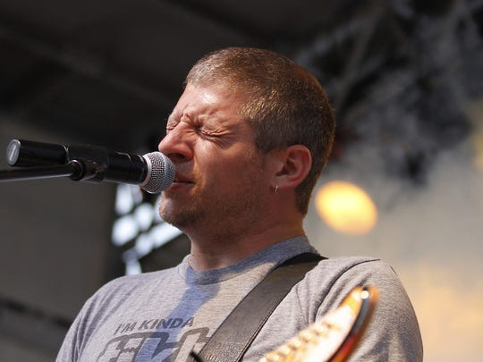 Mike Butterworth of The Nadas sings during a performance in Oskaloosa, part of RAGBRAI.