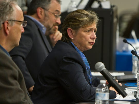 """Carol Rizzo, candidate for Monmouth County Freeholder, answers questions regarding taxes at the Asbury Park Press """"Taxed Out"""" Town Hall."""