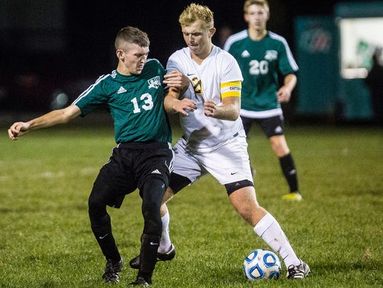 Delta's Isaac Griffis battles for possession against