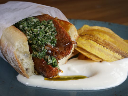 Choripan is a South American chorizo sandwich. Livery chefs will stuff it with housemade chorizo and chimichurri. Livery opens in late  November 2016 at 720 N. College Ave., just off Mass Ave.