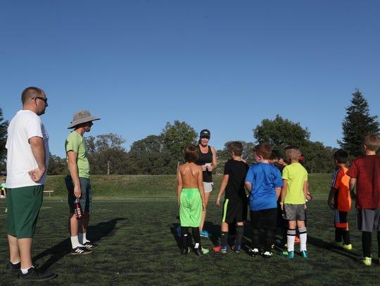 Soccer teams practice last summer at the Redding Soccer