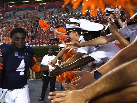 Auburn linebacker Jeff Holland (4) celebrates with fans after the game during the NCAA football game between Auburn vs. Georgia Southern on Saturday, Sept. 2, 2017, at Jordan Hare Stadium in Auburn, Ala. Auburn defeated Georgia Southern 41-7/