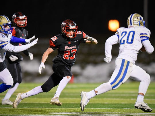 Rocori's Jaden Ruegemer chases Holy Angels back Thomas Shelstad out of bounds during the first half Friday, Nov. 10, at Husky Stadium.