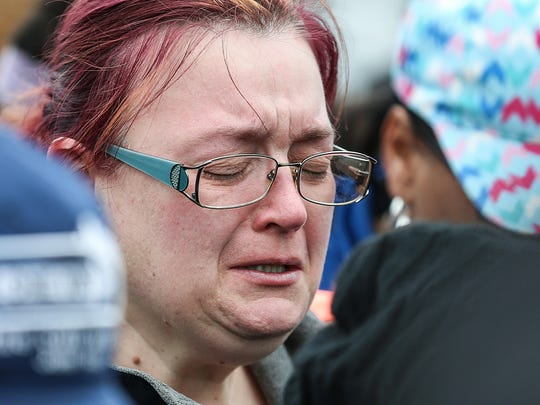 """Robin Robson, Malaysia's grandmother, sheds tears during the """"Let's March for Malaysia"""" march led by Ten Point Coalition after the recent death of 1-year-old Malaysia Robson on the east side of Indianapolis, Saturday, March 31, 2018. The group marched from 38th Street and Post Road to the home where Malaysia was fatally shot in the early hours of March 29, 2018."""