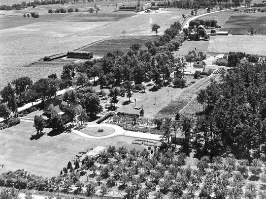 Aerial view of the entire Pinehurst farm looking south southeast toward the signature dairy barns taken prior to 1942.   What is now Highway 32 is the road at left. Highway 28 does not yet exist--it later bisects the property.