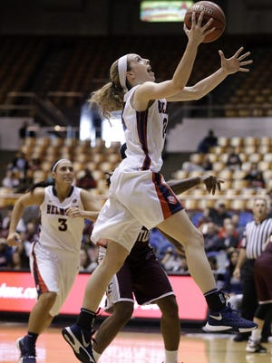 Jenny Roy scores March 5 against Eastern Kentucky as Belmont wins the Ohio Valley Conference women's basketball tournament.