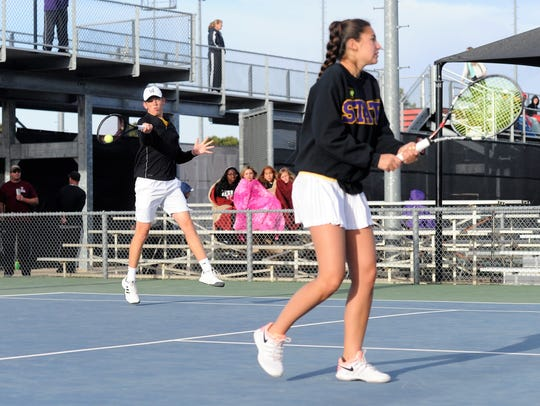 Wylie's Davyn Williford hits a shot behind mixed doubles
