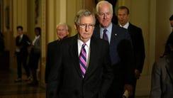 Senate Majority Leader Mitch McConnell, R-Ky., left
