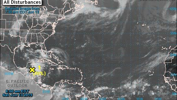 National Hurricane Center officials in Miami are monitoring a weak disturbance in the southwestern Gulf of Mexico