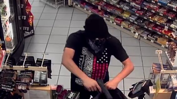 This surveillance photo shows a robbery that occurred Feb. 13 at a Palm Springs AM/PM store on Vista Chino.