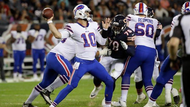 Buffalo Bills quarterback AJ McCarron (10) throws against the Chicago Bears during the first half of an NFL preseason football game in Chicago, Thursday, Aug. 30, 2018. (AP Photo/Nam Y. Huh)