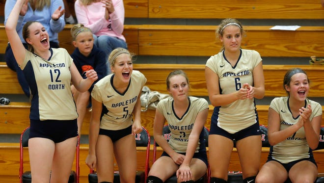 Appleton North players celebrate a point during their Fox Valley Association girls' volleyball match against Hortonville on Sept. 4.