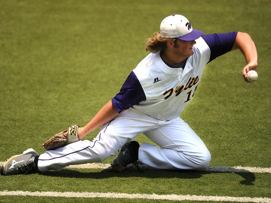 Wylie pitcher Connor Carlton (15) flips the ball to first base while fielding a bunt during the top of the second inning of the Bulldogs' 7-5 win in the Class 4A state semifinal baseball game on Wednesday, June 8, 2016, at Disch-Falk Filed in Austin.