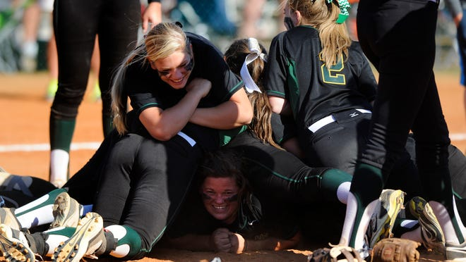 Edgewood pitcher Kelsey Hartley is buried under the dogpile after beating Marengo Academy for the AISA Class A state title at Lagoon Park on Saturday.