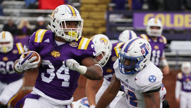 Tennessee Tech running back Yeede Thaenrat tries to elude Tennessee State linebacker Chris Collins in Saturday's game in Cookeville.