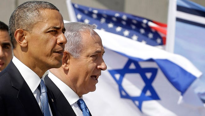 President Obama and Israeli Prime Minister Benjamin Netanyahu tour the Iron Dome Battery defense system, at the Ben Gurion International Airport in Tel Aviv, Israel, on March 20, 2013. The system was developed as a joint project by the two countries.
