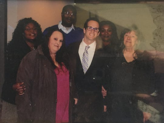 Nicky Cooper (from left, back row), Keith Cooper and Lakeisha Cooper posed for a picture the day of Keith Cooper's parole board hearing in February 2014 in Downtown Indianapolis. In front of them are Nona Canell, right; Elliot Slosar, Cooper's attorney; and Christina Smallwood, Canell's daughter.