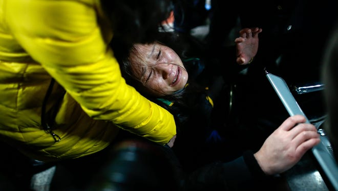 A woman grieves in a hospital where some of the injured from the stampede were admitted in Shanghai on Jan. 1.