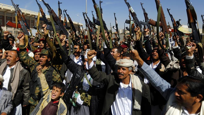 Tribal gunmen loyal to the Shiite Houthis Group shout slogans and hold weapons during a gathering in Sanaa, Yemen, on Feb. 4, 2015.