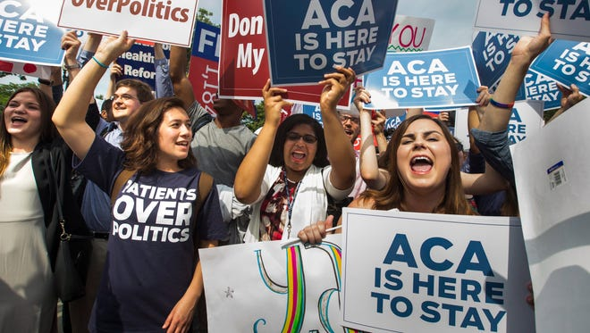 Supporters of the Affordable Care Act cheer after the Supreme Court ruled that Obamacare tax credits can go to residents of any state on Thursday.
