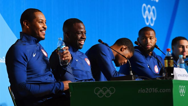 05455467.jpg epa05455467 Basketball players Carmelo Anthony (L) and Draymond Green (2-L) of the USA attend a press conference at the Main Press Centre prior to the Rio 2016 Olympic Games in Rio de Janeiro, Brazil, 04 August 2016. The Rio 2016 Olympic Games will take place from 05 August until 21 August 2016.  EPA/DEAN LEWINS AUSTRALIA AND NEW ZEALAND OUT