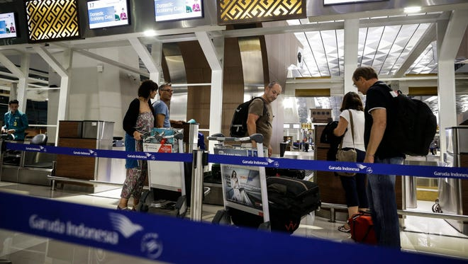 Foreign passengers stand in queue at airport check-in counters on the first day of operations of the new Terminal 3 Ultimate at the Soekarno-Hatta airport in Jakarta, Indonesia, Aug. 9, 2016.